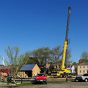Pavillion wall hoisting day begins, and the crane is put into postion. The crane's boom is 105' long (tall!).