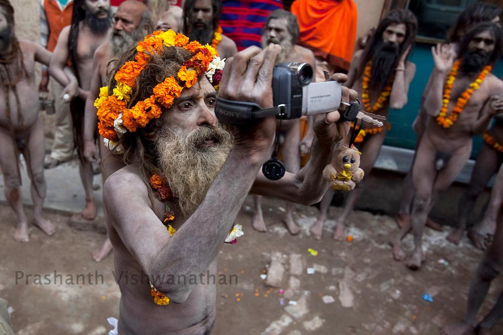 "A Naga sadhu holds a Sony video camera during the ""Shahi Snan"" (royal bath) during the Maha Kumbh ceremony in Haridwar, February 12, 2010.  Photographer:Prashanth Vishwanathan"
