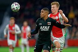 Perr Schuurs #2 of Ajax and Myron Boadu #9 of AZ Alkmaar in action during the Dutch Eredivisie match round 25 between Ajax Amsterdam and AZ Alkmaar at the Johan Cruijff Arena on March 01, 2020 in Amsterdam, Netherlands