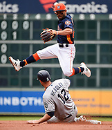 Houston Astros second baseman Jose Altuve, top, drops the ball while attempting a double play over San Diego Padres' Chase Headley during the second inning of a baseball game, Sunday, April 8, 2018, in Houston. Hunter Renfroe was safe at first. (AP Photo/Eric Christian Smith)