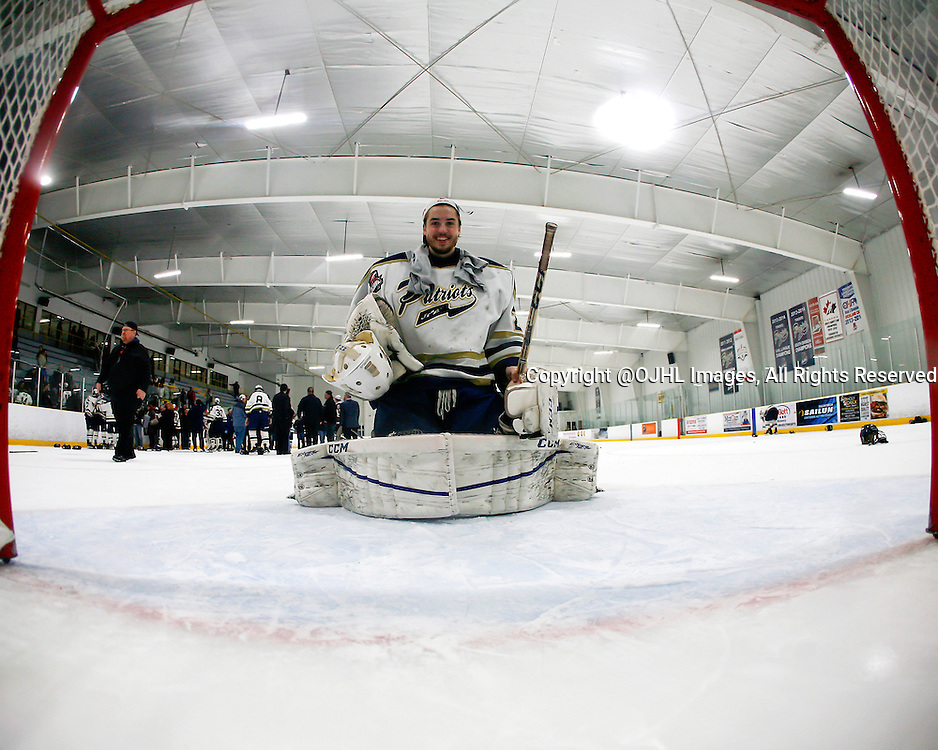 TORONTO, ON - Apr 22, 2015 : Ontario Junior Hockey League game action between the Kingston Voyageurs and the Toronto Patriots. Game seven of the Buckland Cup Championship Series. Mathew Robson #20 of the Toronto Patriots poses for the net cam after winning to 2014-15 Playoff MVP.<br /> (Photo by Brian Watts / OJHL Images)