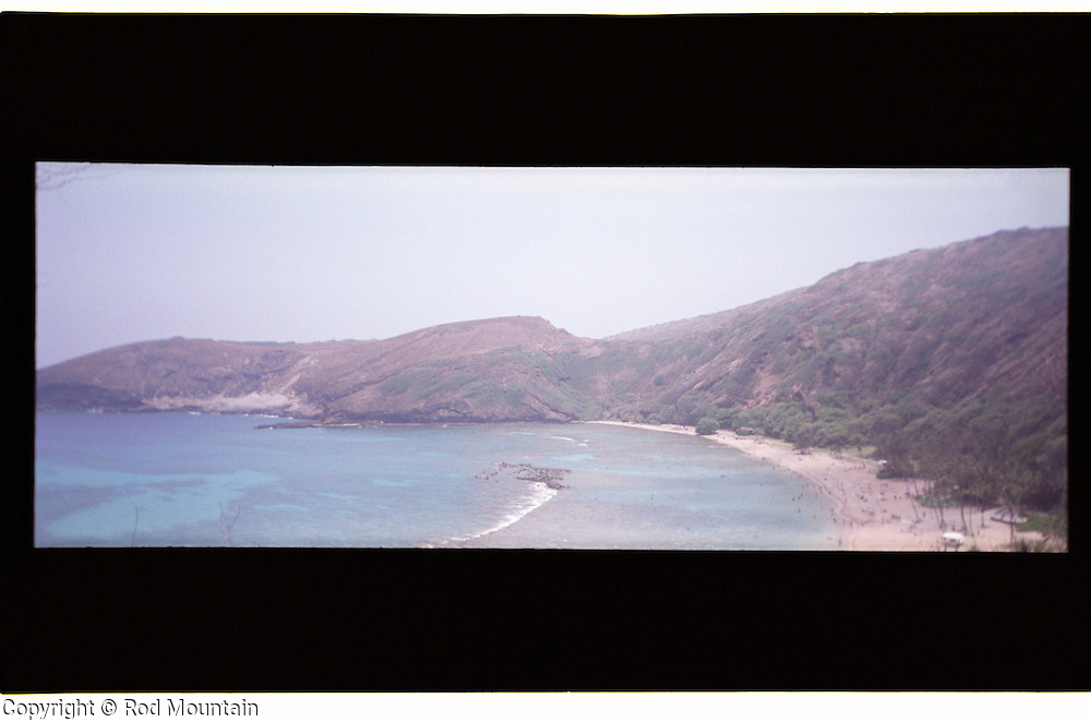"""A Hawaii beach scene taken with a lomography film camera in 4 x 11"""" aspect ratio."""