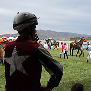 Jockey's prepare to mount their rides during a day at the Races at the Cromwell Race meeting, Cromwell, Central Otago, New Zealand. 27th November 2011. Photo Tim Clayton