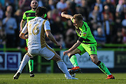 Forest Green Rovers George Williams(11) takes on Milton Keynes Dons Russell Martin(16) during the EFL Sky Bet League 2 match between Forest Green Rovers and Milton Keynes Dons at the New Lawn, Forest Green, United Kingdom on 30 March 2019.
