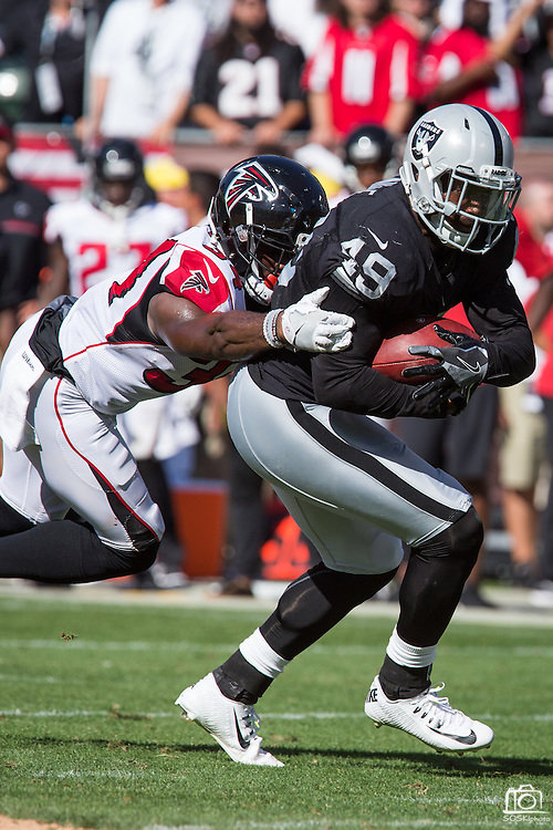 Oakland Raiders running back Jamize Olawale (49) carries the ball against the Atlanta Falcons at Oakland Coliseum in Oakland, Calif., on September 18, 2016. (Stan Olszewski/Special to S.F. Examiner)
