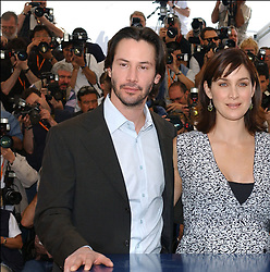 © Arnal-Hahn-Nebinger/ABACA. 45620-1. Cannes-France, 15/05/2003. US actors Keanu Reeves, Carrie-Anne Moss and Laurence Fishburne pose at a photocall for their film Matrix Reloaded presented out of competition at the 56th Cannes Film Festival.  Cannes Film Festival Festival de Cannes Festival du Film de Cannes Cannes Film Festival Fishburne Laurence Fishburne Lawrence Fishburne Laurence Fishburne Lawrence Matrix Reloaded Matrix 2 The Matrix Reloaded Moss Carrie-Anne Moss Carrie-Anne Reeves Keanu Reeves Keanu Presentation de film Presentation de serie Movie Screening<br />