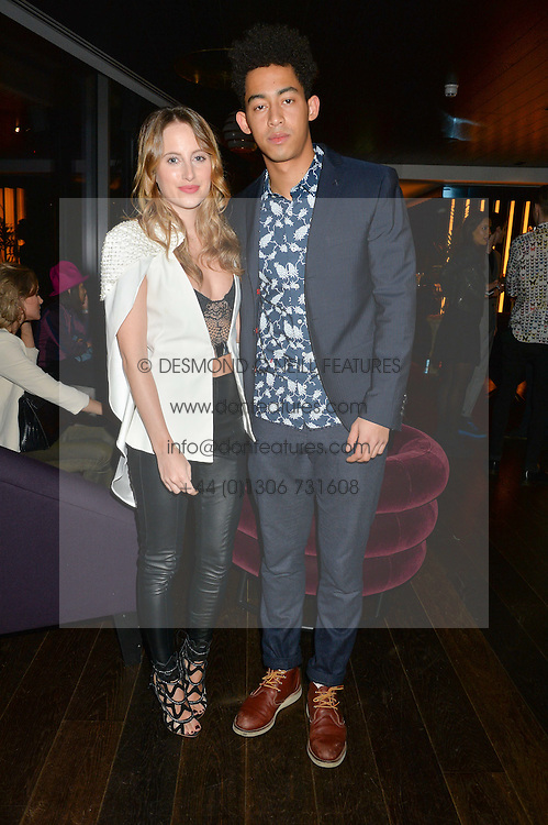 ROSIE FORTESCUE and JORDAN STEPHENS at a party hosted by Christian Lacroix partnered with Supa Model Management to celebrate London Men's Collections January 2015, held at the Rumpus Room, the roof top bar at the top of the Mondrian London, 20 Upper Ground, London SE1 on 12th January 2015.