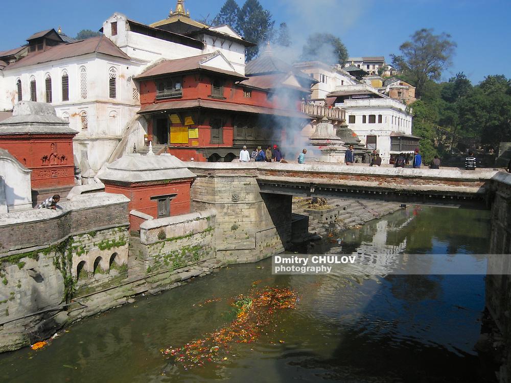 Kathmandu, Nepal - November 27, 2005: Hindu temple of Pashupatinath, seen from across the Bagmati river where traditional cremations take place, in Kathmandu, Nepal.
