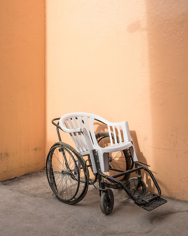 A dilapidated wheelchair at the Bernard Mevs Hospital on Wednesday, December 17, 2014 in Port-au-Prince, Haiti.