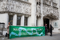 London, UK. 15th January, 2019. Environmental campaigners from Foil Vedanta protest outside the Supreme Court where British mining company Vedanta Resources is appealing High Court and Court of Appeal rulings that 1,826 Zambian villagers may have their case regarding pollution against the company's Konkola Copper Mines (KCM) heard in the UK. The villagers contend that Konkola Copper Mines has polluted the River Kafue with excessive levels of copper, cobalt and manganese since 2004, causing sickness, deaths, damage to property and loss of income.