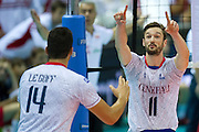 (R) Julien Lyneel from France celebrates winning point during the 2013 CEV VELUX Volleyball European Championship match between Poland and France at Ergo Arena in Gdansk on September 21, 2013.<br /> <br /> Poland, Gdansk, September 21, 2013<br /> <br /> Picture also available in RAW (NEF) or TIFF format on special request.<br /> <br /> For editorial use only. Any commercial or promotional use requires permission.<br /> <br /> Mandatory credit:<br /> Photo by &copy; Adam Nurkiewicz / Mediasport