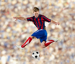 Soccer player kicking ball in air (Credit Image: © Image Source/Pete Saloutos/Image Source/ZUMAPRESS.com)