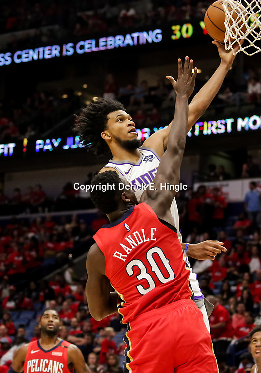Oct 19, 2018; New Orleans, LA, USA; Sacramento Kings forward Marvin Bagley III (35) shoots over New Orleans Pelicans forward Julius Randle (30) during the second quarter at the Smoothie King Center. Mandatory Credit: Derick E. Hingle-USA TODAY Sports