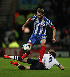 Nick Powell of Wigan Athletic (Top) and Ben Pearson of Preston North End in action - Mandatory by-line: Jack Phillips/JMP - 23/09/2016 - FOOTBALL - Deepdale - Preston, England - Preston North End v Wigan Athletic -  EFL Sky Bet Championship