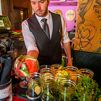 Bartender Brian Johnston works with craft cocktail infusion ingredients Mezcal Restaurant on Main Street in Riverside, Wednesday, Feb., 25, 2015.  (Eric Reed/For Riverside Magazine)