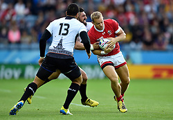 Harry Jones of Canada takes on the Romania defence - Mandatory byline: Patrick Khachfe/JMP - 07966 386802 - 06/10/2015 - RUGBY UNION - Leicester City Stadium - Leicester, England - Canada v Romania - Rugby World Cup 2015 Pool D.