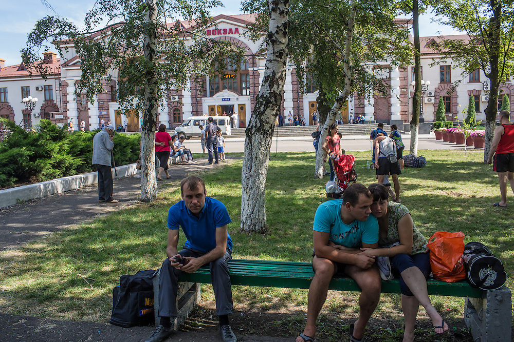 People wait for their trains out away from areas with heavy fighting on Monday, July 28, 2014 in Yasinovataya, Ukraine.