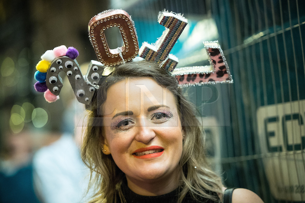 "© Licensed to London News Pictures . 01/01/2017 . Manchester , UK . A woman wearing "" 2017 "" headwear . People on a night out in Manchester City Centre , after midnight on January 1st 2017 . Photo credit : Joel Goodman/LNP"
