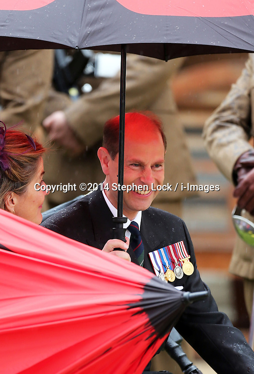 Image ©Licensed to i-Images Picture Agency. 28/06/2014. London, United Kingdom. The Earl of Wessex shelters from the rain  at the Solemn Drumhead Service at the Royal Hospital Chelsea, London. The service was to commemorate those who volunteered to serve in the First World War on the Centenary of the assassination of Archduke Franz Ferdinand.  Picture by Stephen Lock / i-Images