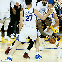 01 June 2017: Cleveland Cavaliers guard Kyrie Irving (2) drives past Golden State Warriors guard Stephen Curry (30) and Golden State Warriors center Zaza Pachulia (27) during the Golden State Warriors 113-90 victory over the Cleveland Cavaliers, in game 1 of the 2017 NBA Finals, at the Oracle Arena, Oakland, California, USA.