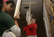 A Kent State volunteer squints at the falling dust while replacing drywall Wednesday, March 26, 2006, in a home in Pass Christian, Miss.<br /> <br /> Photo by Michele Roehrig<br /> <br /> horizontal, biloxi, aternative spring break, student