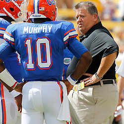 October 8, 2011; Baton Rouge, LA, USA;  Florida Gators offensive coordinator Charlie Weis talks quarterbacks Jacoby Brissett (17) and Tyler Murphy (10)  prior to kickoff of a game against the LSU Tigers at Tiger Stadium.  Mandatory Credit: Derick E. Hingle-US PRESSWIRE / © Derick E. Hingle 2011