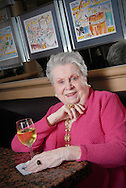 Portrait of Ella Brennan, matriarch of one of the most famous restaurant families of the south, the Brennan family, sitting at the Chef's Table at Commander's Palace restaurant in New Orleans.