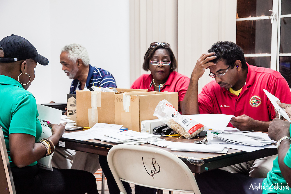 (L-R) Colette White-Amaro, Hulbert Lewis, Alicia M. Wells, Lawrence Boschulte.  Tallying the Votes.  Board of Elections.  8 September 2012.  © Aisha-Zakiya Boyd