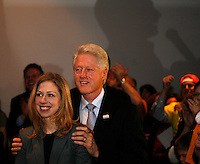 US Democratic presidential candidate Sen. Hillary Clinton (D-NY) casting a shadow on the wall (R), gives a victory speech with her husband former US President Bill Clinton (C) and daughter Chelsea (L) watching after winning the Democratic caucuses in Las Vegas January 19, 2008.  REUTERS/Rick Wilking  (UNITED STATES)  US PRESIDENTIAL ELECTION CAMPAIGN 2008 (USA)