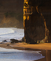 Rugged sandstone cliffs and rough waves near Port Campbell, Great Ocean Road, Victoria, Australia