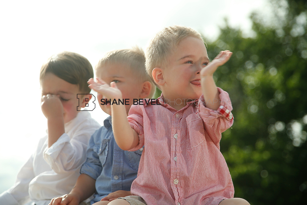 5/28/15 5:39:54 PM -- Miracle Miles and his family pose for portraits and play at the QuikTrip park for the 2015 Saint Francis Health System advertising campaign. <br /> <br /> Photo by Shane Bevel