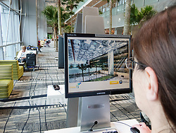 Public free internet access computer screens at Terminal 3 in Changi Airport in Singapore