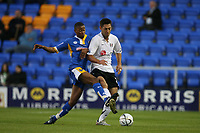 Photo: Rich Eaton.<br /> <br /> Shrewsbury Town v Fulham. Carling Cup. 28/08/2007. Shrewsbury's Chris HUmphrey (l) tackles Clint Dempsey of Fulham.