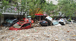 July 27, 2017 -Yulin, China - Damaged cars are piled up on each other on the street after a flood in Suide county of Yulin city, northwest China's Shaanxi Province. Six people are reported dead in a rain-triggered flood, local authorities said.  (Credit Image: © Zhang Bowen/Xinhua via ZUMA Wire)