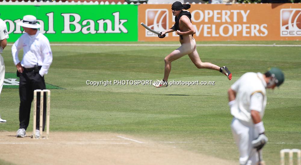 A streaker invades the pitch on Day 3 of the 2nd test match.  New Zealand Black Caps v Pakistan, Test Match Cricket. Basin Reserve, Wellington, New Zealand. Monday 17 January 2011. Photo: Andrew Cornaga/photosport.co.nz