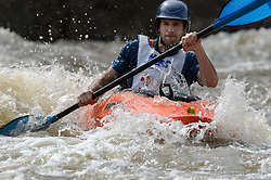 "Chad Sierman of Cape Girardeau, Mo. races in the K1 Men's Novice/Expert class on the slalom course of the 45th Annual Missouri Whitewater Championships. Sierman placed second in the class, first in the downriver K1 Men's Plastic (30-49) class and sixth in the K1 Men's Long Plastic 30 and up class. The Missouri Whitewater Championships, held on the St. Francis River at the Millstream Gardens Conservation Area, is the oldest regional whitewater slalom race in the United States. Heavy rain in the days prior to the competition sent water levels on the St. Francis River to some of the highest heights that the race has ever been run. Only expert classes were run on the flood level race course. Novices who chose to race were re-classified as ""novice experts"" to recognize their achievements."