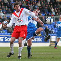 Airdrie Utd's Stuart Taylor and St Johnstone's Peter MacDonald in action in the Scottish First Division match played at McDiarmid Park 20th January 2007.