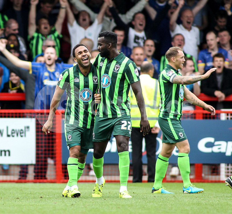 Andy Barcham of AFC Wimbledon scores to make it 1-2 and celebrates during the Sky Bet League 2 match between Crawley Town and AFC Wimbledon at the Checkatrade.com Stadium, Crawley, England on 15 August 2015. Photo by Ken Sparks.