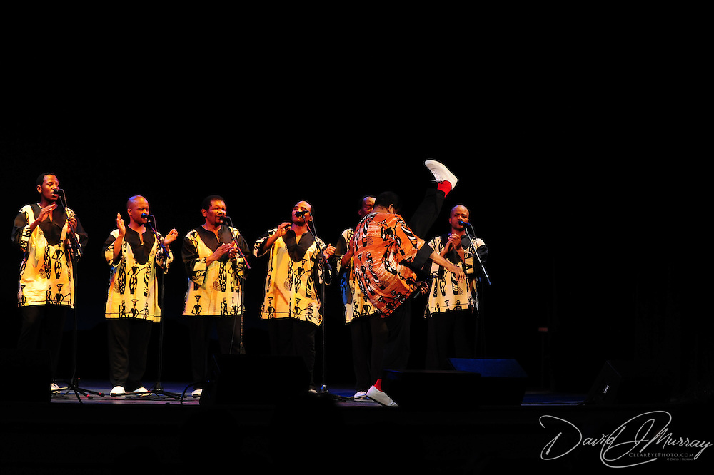 Ladysmith Black Mambazo founder and leader Joseph Shabalala high kicking at The Music Hall, Portsmouth, NH
