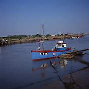 A3AAJ5 Small inshore fishing trawler boat by a jetty River Blythe Walberswick Suffolk England