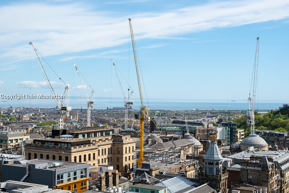 Construction tower cranes at construction site of New St James Centre development in Edinburgh, Scotland, United Kingdom,UK