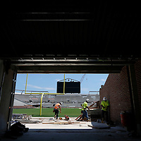 Thomas Wells | Buy at PHOTOS.DJOURNAL.COM<br /> Workers continue to build stairs leading from newly build feild level at the South endzone as Ole Miss works to complete a stadium expansion that is scheduled to be complete by the end of August 2016.