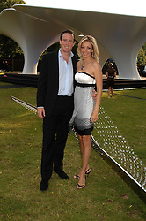 NADJA SWAROVSKI and her husband RUPERT ADAMS at the annual Serpentine Gallery Summer Party in association with Swarovski held at the gallery, Kensington Gardens, London on 11th July 2007.<br />