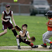 Larchmont, NY / 2007 - Julianna Capasso waits for a throw while base runner Kim Chiapparelli slides safely into second base during a game at Central School in Larchmont  July 13.   Outfielder Lorna Begg stands behind the play. ( Mike Roy / The Journal News )