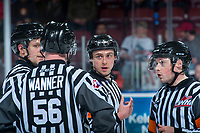 KELOWNA, CANADA - MARCH 14:  Ice officials stand at centre ice discussing a call at the Kelowna Rockets against the Prince George Cougars on March 14, 2018 at Prospera Place in Kelowna, British Columbia, Canada.  (Photo by Marissa Baecker/Shoot the Breeze)  *** Local Caption ***
