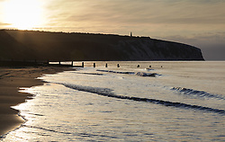 © Licensed to London News Pictures. 25/05/2015. Sandown, Isle of Wight, UK. Sunrise over Culver Down at Sandown Bay on the Isle of Wight this morning, 25th May 2015. The weather is set to be generally dry, with cloud cover and localised sunny spells. Photo credit : Rob Arnold/LNP