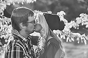 Couple in love. Young heterosexual couple kissing outdoors.