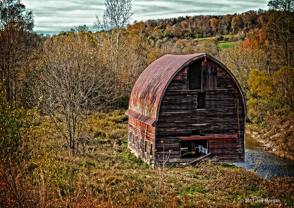 A different perspective of an old dilapidated barn hanging over the edge of the river along Route 79 on the way to Ithaca, NY.