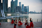 Singapore - A group of dancers with traditional costumes. Marina Bay.