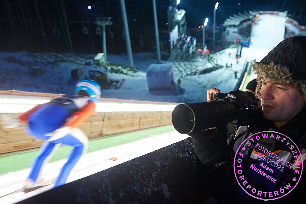 Photographer Rafal Oleksiewicz (Pressfocus Agency) shoots pictures during FIS World Cup Ski Jumping competition in Wisla, Poland on January 15, 2015.<br /> <br /> Poland, Wisla, January 15, 2015.<br /> <br /> Picture also available in RAW (NEF) or TIFF format on special request.<br /> <br /> For editorial use only. Any commercial or promotional use requires permission.<br /> <br /> Mandatory credit:<br /> Photo by &copy; Adam Nurkiewicz / Mediasport